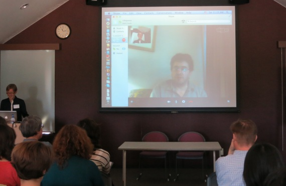 Daniel Hahn appears via Skype from Pakistan.